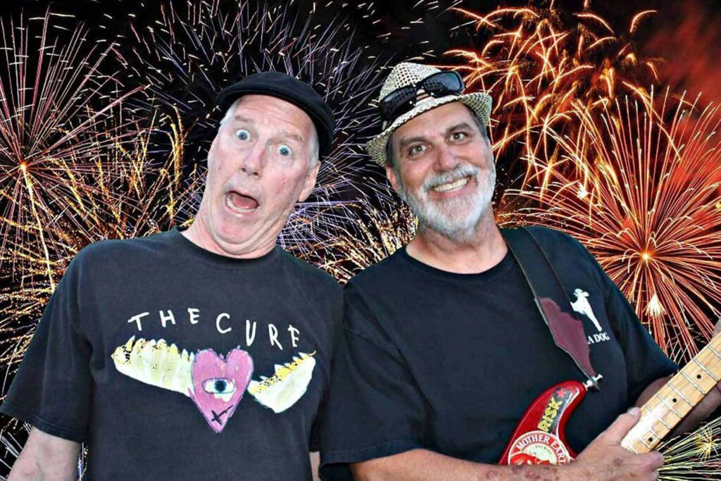 photo of the Will and Tony show with fireworks behind them