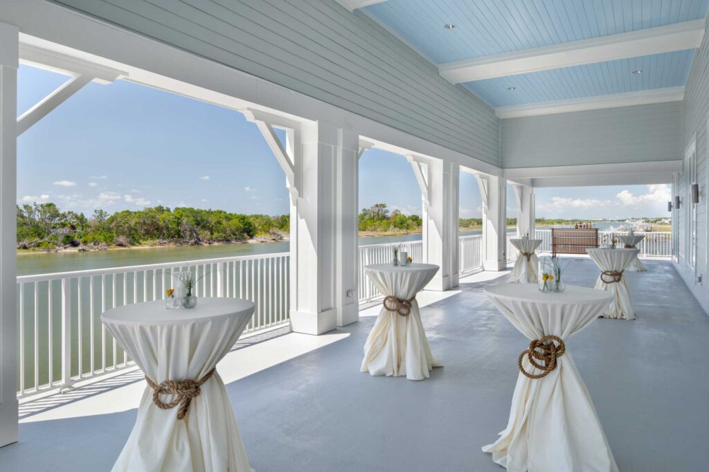 Outdoor Veranda with Tables set up and covered in white cloth